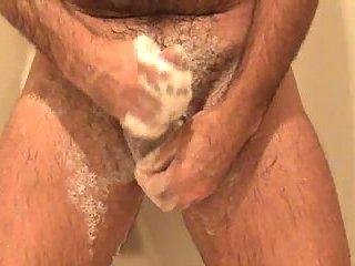 Gay masturbates while taking shower