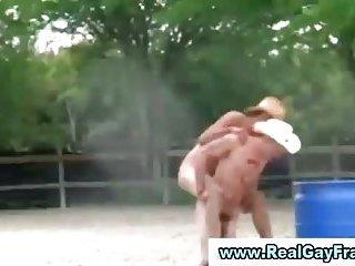 College teens in cowboy hats piggyback naked