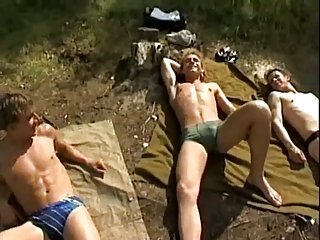 Outdoors sucking twinks orgy near the river