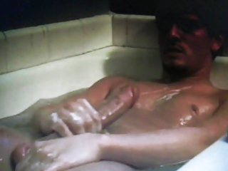 Super hung hot dude in bath lathers up his cock