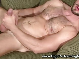 Masculine gay stimulates his feet and nipples