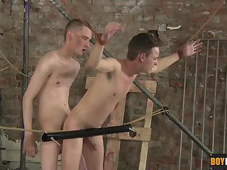 Twink takes a beating with the devious boy flogging his butt